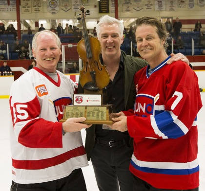 NHL great Mark Napier receives the JUNO Cup from CARAS President and CEO Allan Reid along with rocker Jim Cuddy at the 2015 JUNO Cup. (Photo: CARAS)
