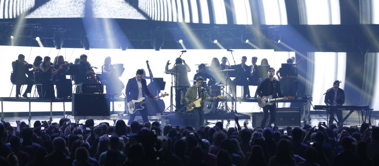 """2015 JUNO Awards Rock Album of the Year award winner Arkells perform """"Come to Light"""" accompanied by Boris Brott and the National Academy Orchestra of Canada at FirstOntario Centre in Hamilton on March 15, 2015. (Photo: CARAS)"""