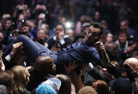 Host Jacob Hoggard surfs the audience to leave the stage during the 2015 JUNO Awards at FirstOntario Centre in Hamilton on March 15, 2015. (Photo: CARAS)
