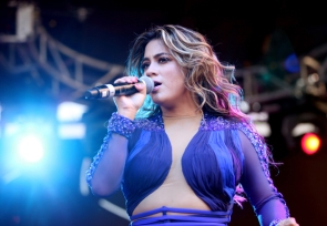 Fifth Harmony performing at Pandora Summer Crush 2015 at L.A. LIVE in Los Angeles on Aug. 15, 2015. (Photo: Chelsea Lauren/Getty)
