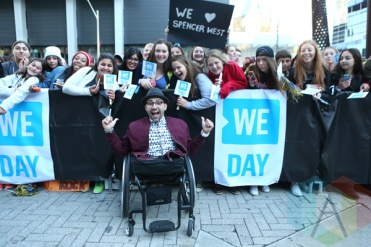 ME to WE motivational speaker, Free The Children ambassador and author, Spencer West at We Day Toronto 2015 at the Air Canada Centre in Toronto on Oct. 1, 2015. (Photo: Chris Young/The Canadian Press)