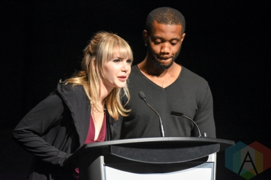 Kandle and Jabbari Weekes present the Audience Award during the 2016 Prism Prize gala at the TIFF Lightbox in Toronto on May 15, 2016. (Photo: Jamie Espinoza/Aesthetic Magazine)