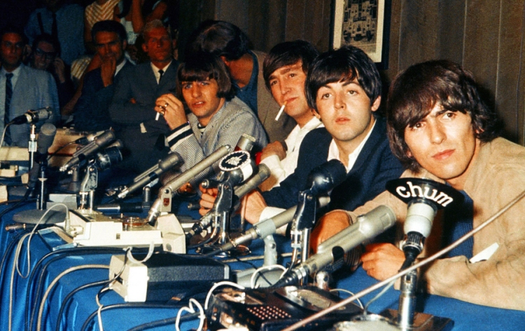 The Beatles at a press conference in the Hot Stove Lounge at Maple Leaf Gardens in Toronto on August 17, 1965. (Photo: John Rowlands)
