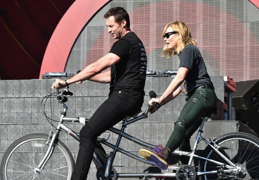 Actor Hugh Jackman (L) and comedian Chelsea Handler ride a tandem bike onstage at the 2016 Global Citizen Festival in Central Park in New York City on September 24, 2016. (Photo: Theo Wargo/Getty)