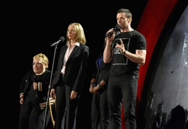 (L-R) Caterpillar Foundation President Michele Sullivan, Vice President of Large Power Systems and Growth Markets Division at Caterpillar Inc. Tana Utley and actor Hugh Jackman speak onstage at the 2016 Global Citizen Festival in Central Park in New York City on September 24, 2016. (Photo: Theo Wargo/Getty)