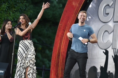 NEW YORK, NY - SEPTEMBER 24: (L-R) Member of Parliament from Mumbai North Central Poonam Mahajan, actress Priyanka Chopra and musician Chris Martin speak onstage at the 2016 Global Citizen Festival In Central Park To End Extreme Poverty By 2030 at Central Park on September 24, 2016 in New York City. (Photo by Theo Wargo/Getty Images for Global Citizen)