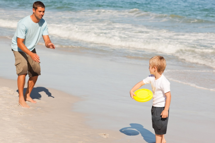 Dad and son playing frisbee