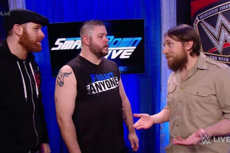 Sami Zayn (L) and Kevin Owens with Smackdown Live GM Daniel Bryan. (Photo: WWE)