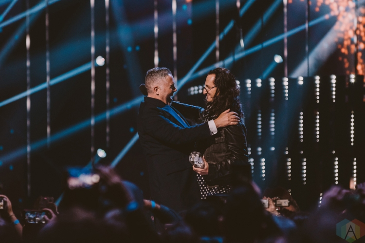 VANCOUVER, BC - MARCH 25: Ed Robertson of Barenaked Ladies and Geddy Lee of Rush embrace at the Juno Awards at Rogers Arena in Vancouver on March 25, 2018. (Photo: Tim Nugyen/Aesthetic Magazine)