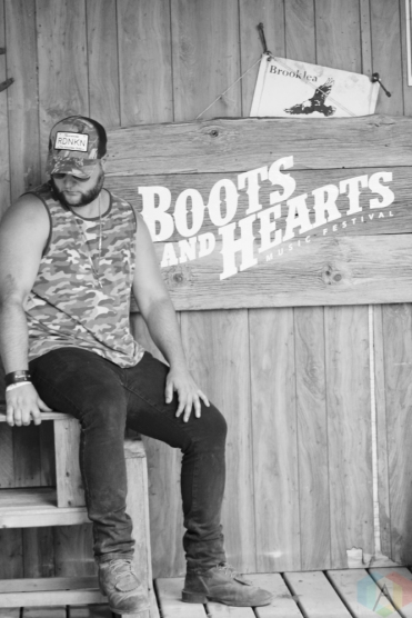 ORO-MEDONTE, ON - AUGUST 11: Chris Buck of Chris Buck Band poses for a portrait at Boots And Hearts Music Festival at Burl's Creek in Oro-Medonte, ON on August 11, 2018. (Photo: Curtis Sindrey/Aesthetic Magazine)